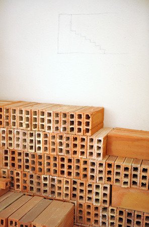 bedchamber: Sketch drawn on the wall, stacked bricks
