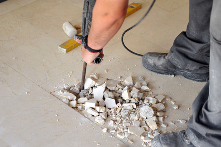 compressed air: Mason raised pavement of a house with mechanical hammer