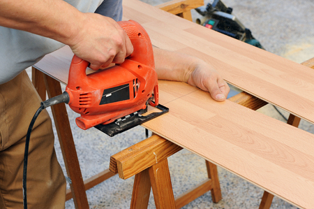cut off saw: Carpenter working with jig saw