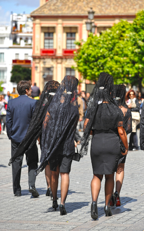 holy week in seville: Women with veil and ornamental comb for Good Friday, Holy Week, Seville, Spain Stock Photo
