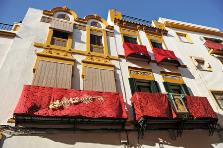 holy week in seville: Holy Week in Seville, balconies decorated in the Triana neighborhood, Andalusia, Spain