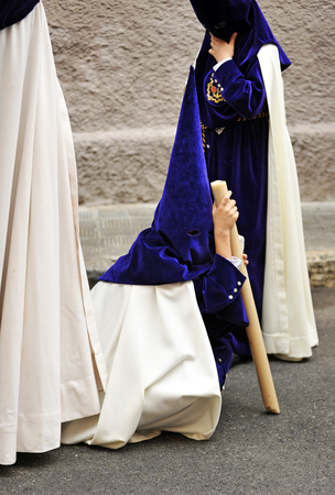 holy week in seville: Tired child during a Holy Week procession in the district of Triana, Seville, Spain