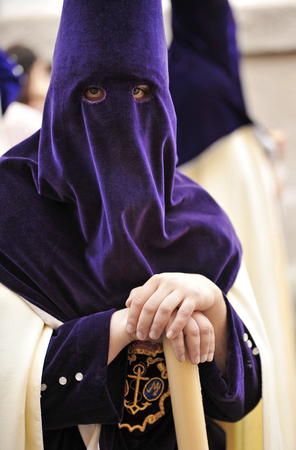 holy week in seville: Nazarene with candle in hand, Holy Week in Triana, Seville, Andalusia, Spain