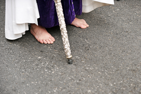holy week in seville: Nazarene walking barefoot, penance, Holy Week in Seville, Andalusia, Spain