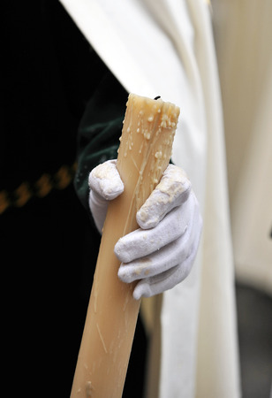 holy week in seville: Nazarene with candle in hand, Holy Week in Seville, Andalusia, Spain Stock Photo
