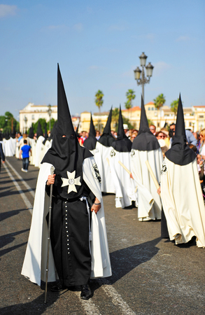 holy week in seville: Nazarenes across the bridge of Triana, Holy Week in Seville, Andalusia, Spain Editorial