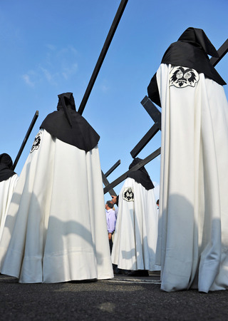 holy week in seville: Holy Week in Seville, Nazarenes with wooden crosses, Andalusia, Spain