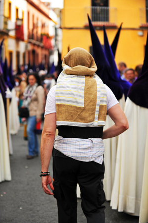 holy week in seville: Loader, costalero, religious procession of Holy Week in Seville, Andalusia, Spain