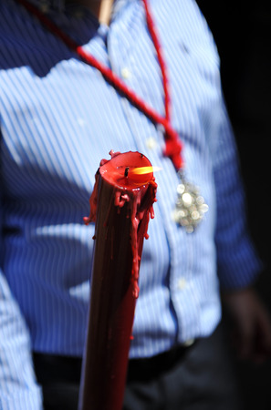 holy thursday: Boy with a lighted candle in hand, Corpus Christi, religious celebration in Seville, Andalusia, Spain
