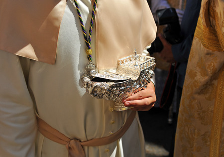 holy thursday: Acolyte with a bowl of silver to incense,  religious procession, Seville, Andalusia, Spain