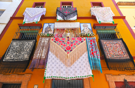 holy week in seville: Balconies of Andalusia decorated for religious processions, Spain Stock Photo