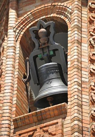 bell bronze bell: Bronze bell in a belfry of bricks, Spain Stock Photo