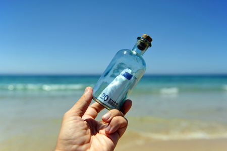 20 euro: 20 euro in a bottle on the hand found on the beach
