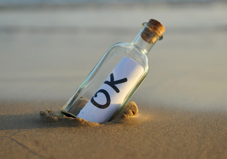 approbate: Bottle on the beach with ok inside