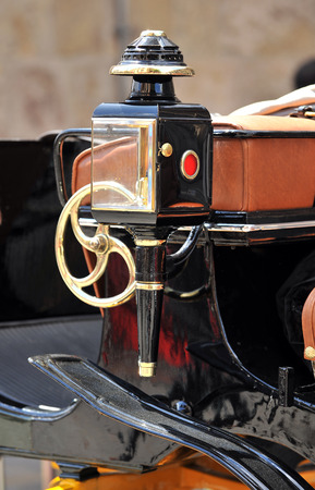 horse and carriage: closeup of a lantern of a horse carriage for tourists,