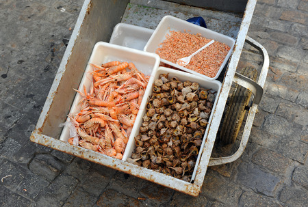 itinerant: Itinerant sale seafood and fish in the streets of Cadiz, Spain Stock Photo