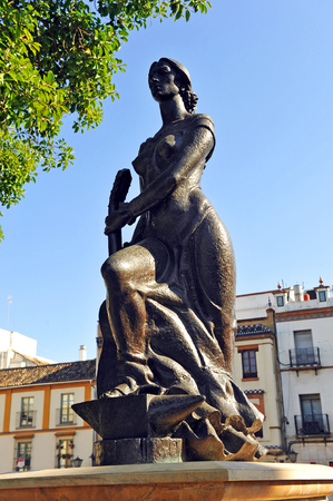 tribute: Tribute to flamenco, Andalusian woman with guitar in the neighborhood of Triana, Seville, Spain