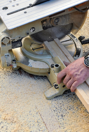 miter: Carpenter working with the miter saw for the reform of the house