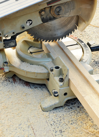 miter: Woodworking tools, miter saw with wooden profile Stock Photo