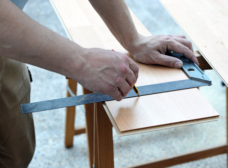 mounter: Operator working with the carpenter square to cut a wooden floor