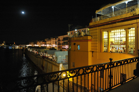 fiesta popular: Night fair of Triana, called La Vela, Seville, Andalusia, Spain, Europe