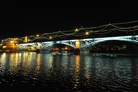 nightime: The famous Triana bridge at night, Seville, Andalusia, Spain, Europe