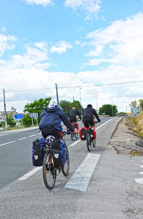 berm: Pilgrims on bicycle in the Camino de Santiago, Via de la Plata, Spain Stock Photo