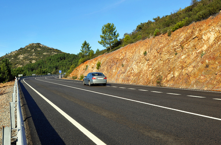 public works: Car on the road, mountain pass of Niefla, Ciudad Real province, Castilla la Mnacha, Spain