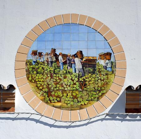 casks: Grape pickers collecting the grapes, tile on the facade of the cellar, Sanlucar de Barrameda, Cadiz province, Spain