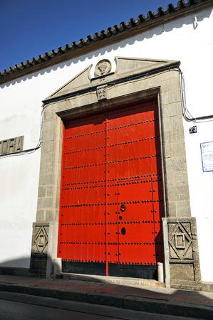 winepress: Entrance door of a wine cellar, Sanlucar de Barrameda, Cadiz province, Spain