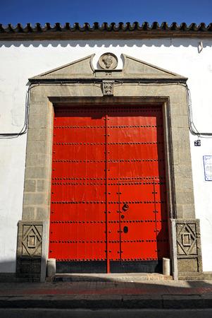 winepress: Entrance door a wine cellar, Sanlucar de Barrameda, Cadiz province, Spain Stock Photo