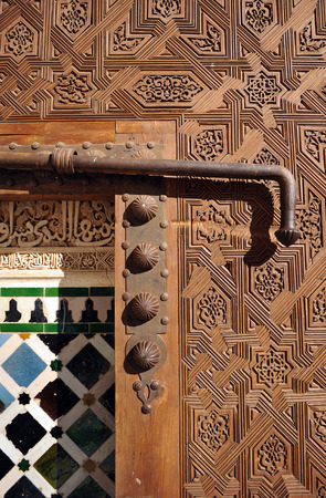 door bolt: Alhambra in Granada, wooden door with bolt, arabic decoration, Andalusia, Spain Editorial