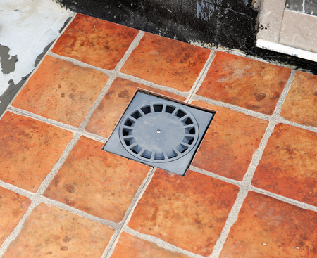 sump: Sump drain in the courtyard of a house