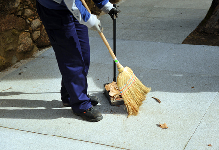 besom: Sweeper street sweeping up with her broom, municipal worker of cleaning