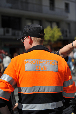 during: Agent of Civil Protection during a popular demonstration, Spain
