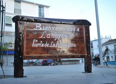 alpujarra: Wooden sign, Welcome to Lanjaron, door of the Alpujarra, province of Granada, Spain
