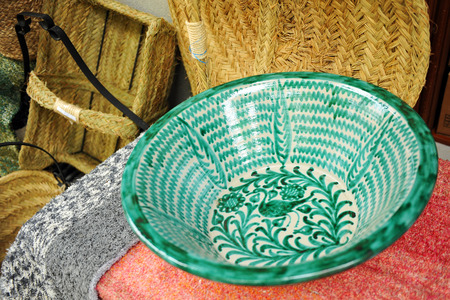 alpujarra: Green ceramic bowl and mat of esparto, crafts typical of the region of the Alpujarra in the province of Granada, Spain Stock Photo