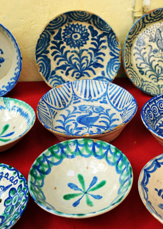 antique dishes: Valuable antique faience dishes, flea market Stock Photo