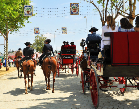 feast: Horses and carriages ride at the fair, feast in Andalusia, Spain