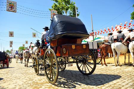 Horse carriage at Sevilla Fair, Fiesta in Spain Фото со стока