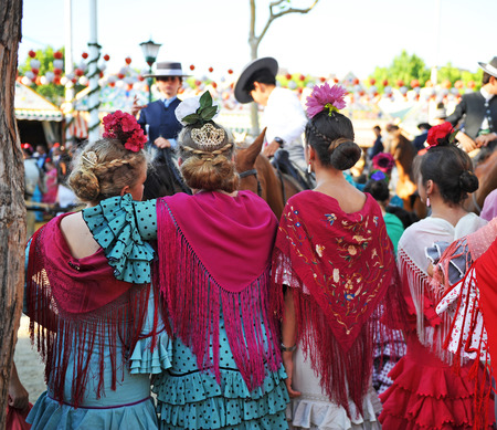 Group of andalusian girls at the fair in Seville, Andalusian feast
