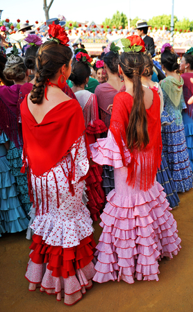 feast: Group of andalusian girls at the fair in Seville, Spanish feast