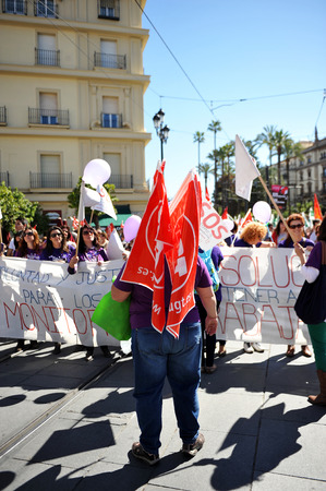 Manifestation on the day of working women 04-2014, Seville, Spain Editorial