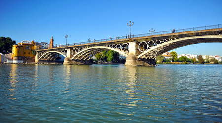 Panoramic view of the Triana bridge over the Guadalquivir River, Seville, Andalusia, Spain