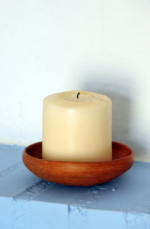warm things: Wax candle in a decorative detail of the house Stock Photo