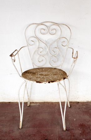 oversight: Old garden chair abandoned, vintage