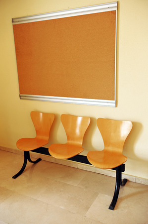 impersonal: Seats in the waiting room and bulletin board in an office of public administration