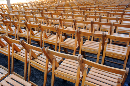 processions: Folding chairs in the street to see the Easter processions in Seville, Spain Stock Photo