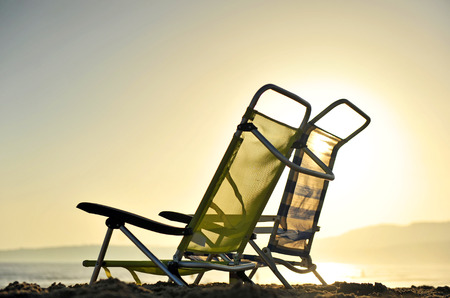 Beach chairs in the bay of Bolonia at sunset, Tarifa, Spain, Southern Europe