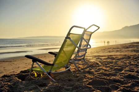 tarifa: Beach chairs in the bay of Bolonia at dusk, Tarifa, Spain, Southern Europe
